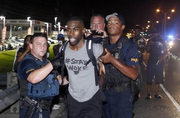 Police arrest activist DeRay Mckesson. Max Becherer / AP